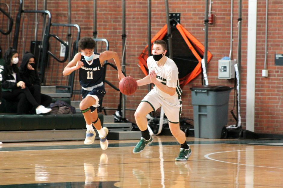 Motivated by last year's season-ending loss to St. Paul in the Class L state tournament and grateful to have the opportunity to be playing this winter, Garrison Kunst, right, and the Maloney boys basketball team is off to a 4-0 start. Brendan O'Sullivan / Special to the Record-Journal
