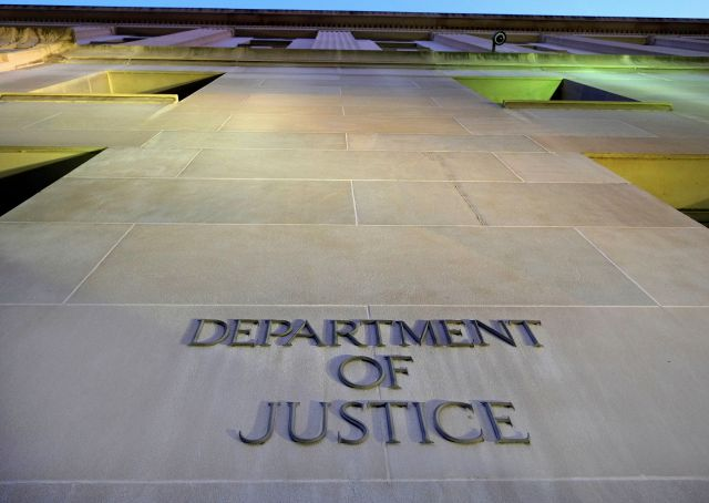 FILE - In this May 14, 2013, file photo, the Department of Justice headquarters building in Washington is photographed early in the morning. (AP Photo/J. David Ake, File)