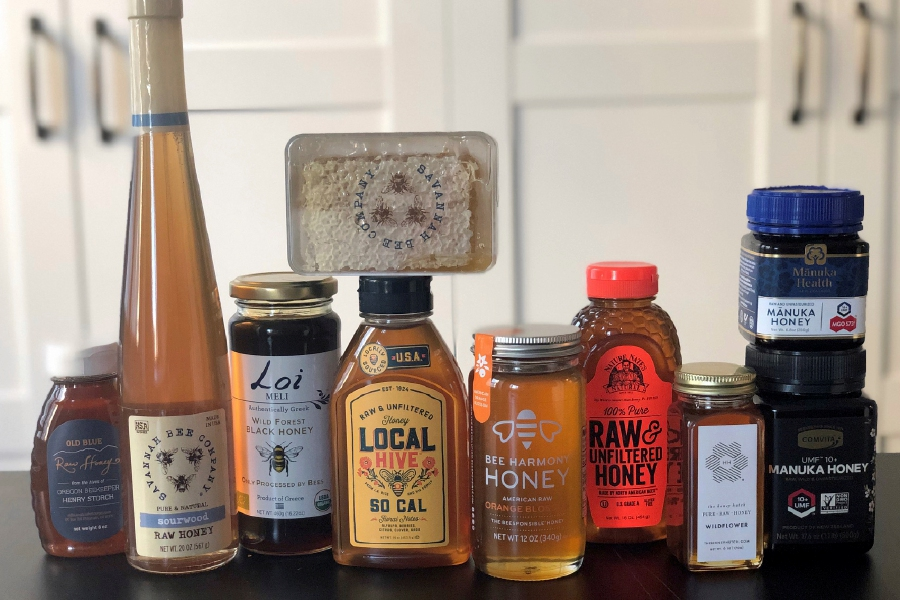 This February 24, 2020 photo taken in New York, shows some of the many brands and types of honey available today. Honey isn