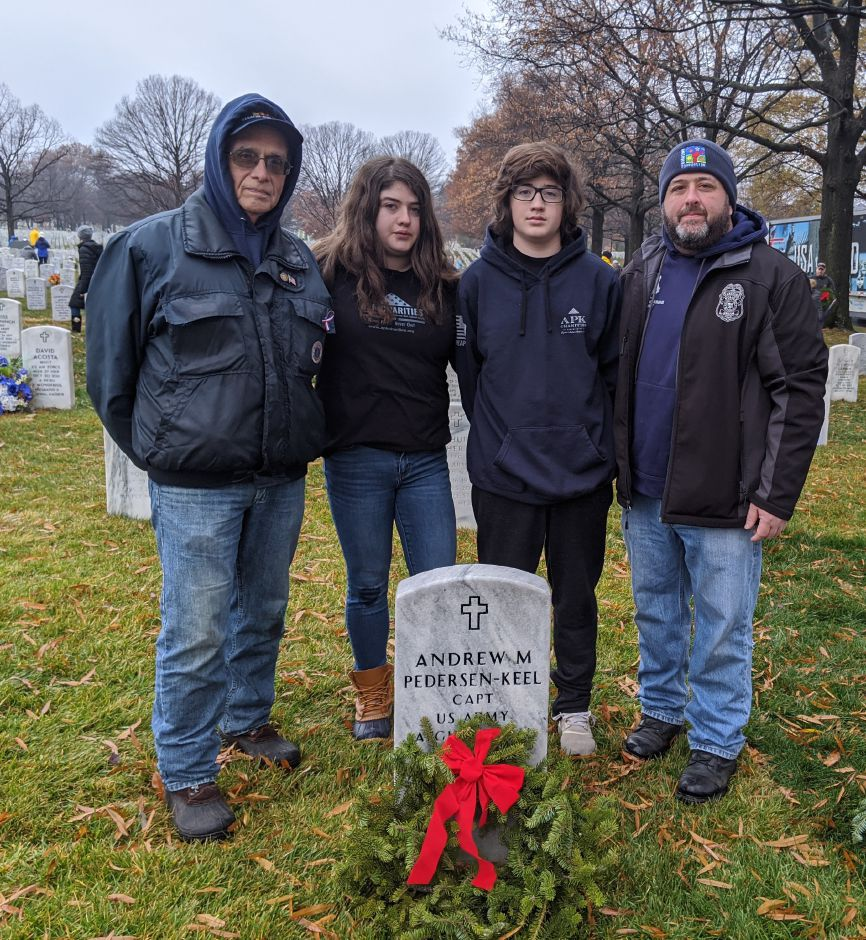 At right, Hayley is pictured with (from left) her grandfather Don, her brother Jack and dad Jeff during one of the Falk family's annual visits to Arlington National Cemetery for Wreaths Across America. Photo courtesy of Hayley Falk.