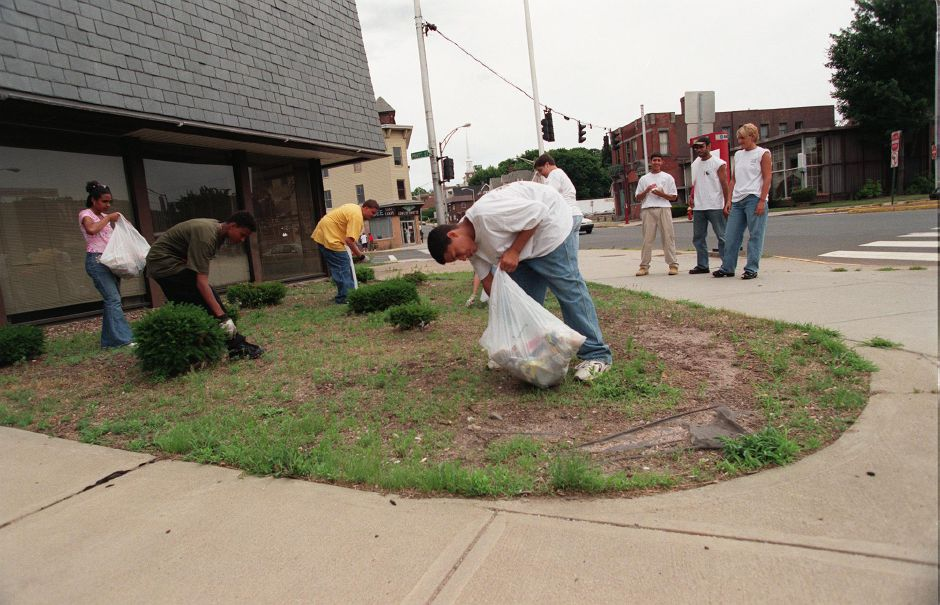 Meriden Youth Services workers including Jamie Molina, foreground, picking up trash in the Meriden Hub Mon., July 12, 1999.