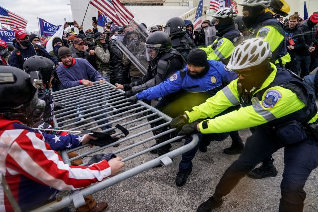 FILE - In this Jan. 6, 2021, file photo rioters try to break through a police barrier at the Capitol in Washington. Congress is set to hear from former security officials about what went wrong at the U.S. Capitol on Jan. 6. That