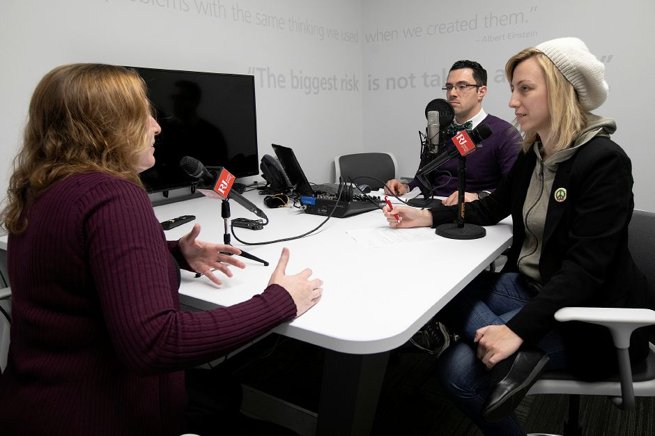 "Sarah DiMeo, left, producer of ""Faded Out,"" discusses her program during a podcast with reporter, Lauren Takores and Local & State News Editor Mike Savino, at the Record-Journal in Meriden, Fri., Dec. 7, 2018. DiMeo"