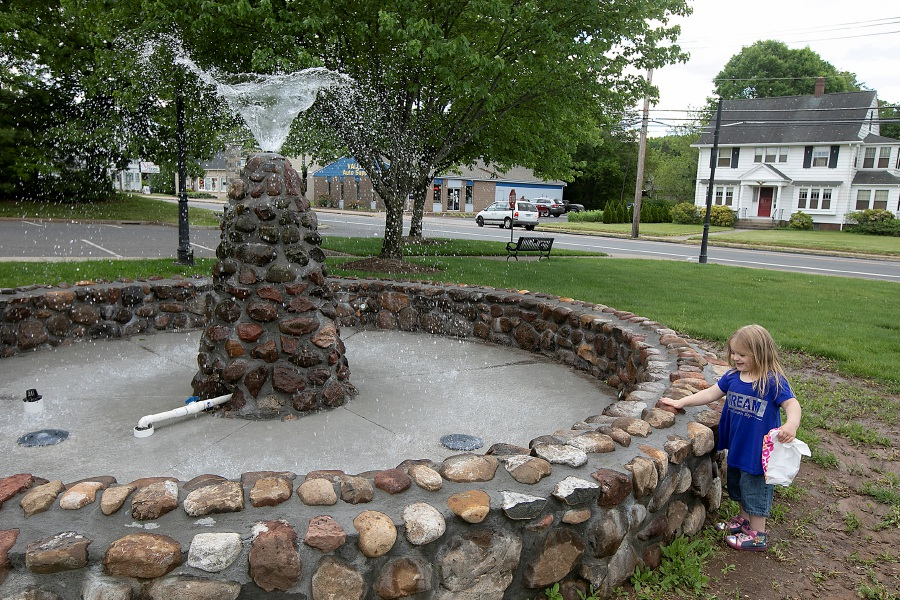 Angelica Turgeon, 3, of Southington, visits the Walkley Fountain after a stop at Dunkin