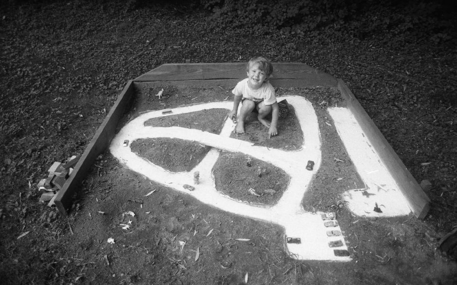 RJ file photo - Michael Moyles, 3, plays with the road system and airport his father, Joe, built of concrete at their Ann Street home in Meriden, Aug. 1989.