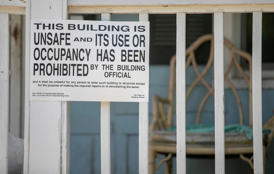 A sign prohibiting occupancy posted at 8 Jackson St. in Meriden, Mon., Jun. 29, 2020. Eleven people remain displaced following a blaze at the home Sunday evening. Dave Zajac, Record-Journal