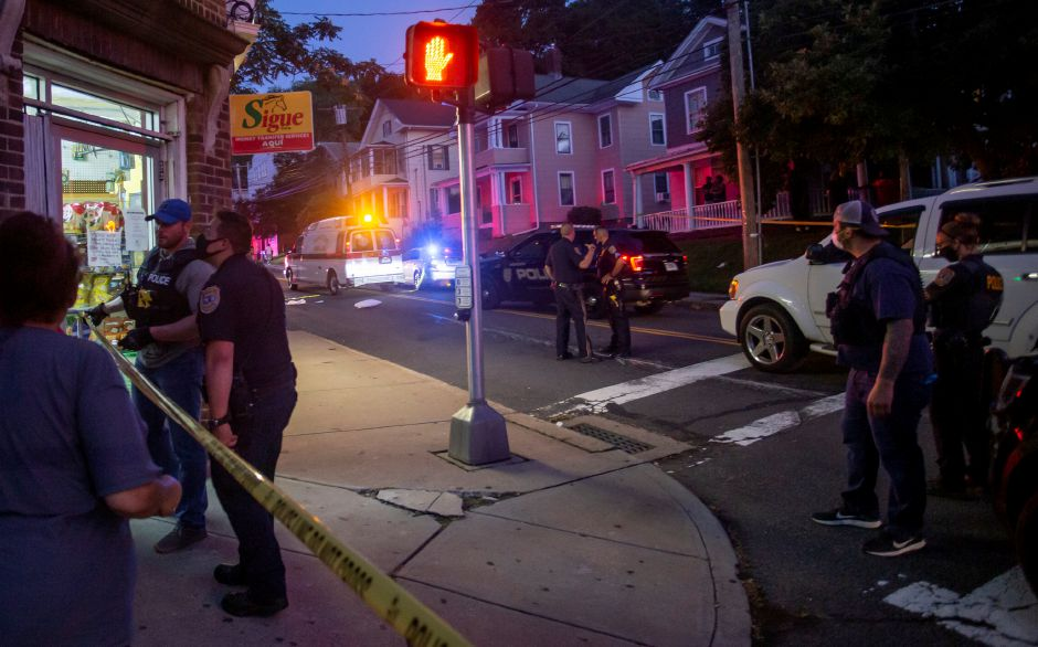 An ambulance leaves the scene as Meriden police investigate a shooting on Olive Street near the intersection with Crown Street Wednesday night Aug. 19, 2020. | Richie Rathsack, Record-Journal