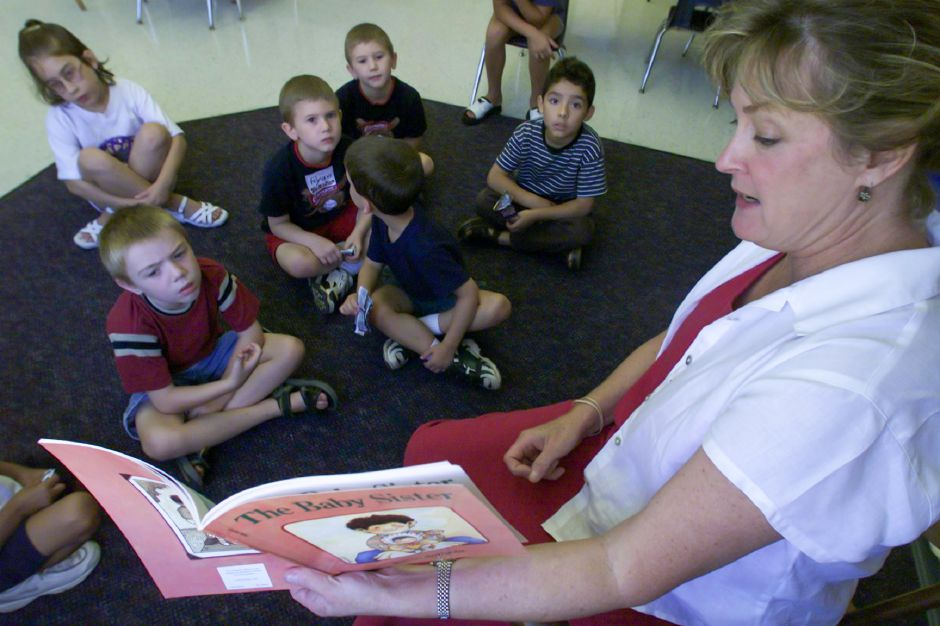 First grade teacher Marjorie Tucci reads to students enrolled in the summer reading program at John Barry School Aug. 10, 2000.
