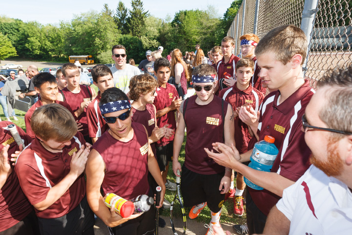 Sheehan's Matt Pereira, left, and Connor Reed, both in headbands, get cheered as they take the court . | Justin Weekes / For the Record-Journal