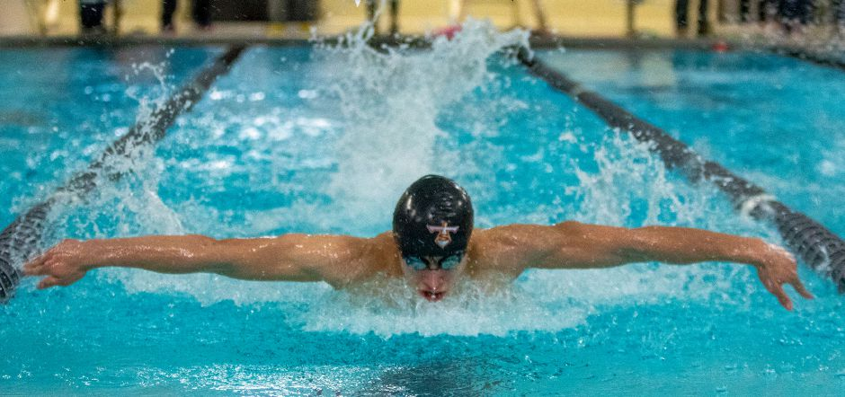 Sheehan's Adam DiDomenico swims the butterfly leg of the 200 individual medley during Wednesday's rivalry meet against Lyman Hall/Coginchaug at Sheehan. Aaron Flaum, Record-Journal