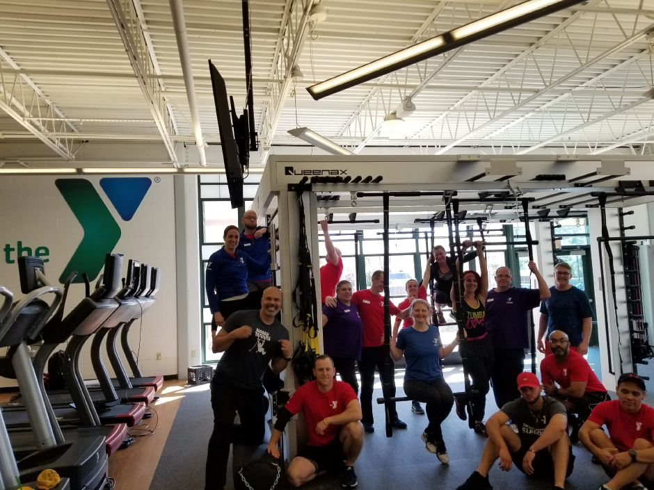 Wheeler YMCA trainers pose in the newly renovated wellness center next to the new QueenAx equipment machine. |Chris Hibbs, contributed