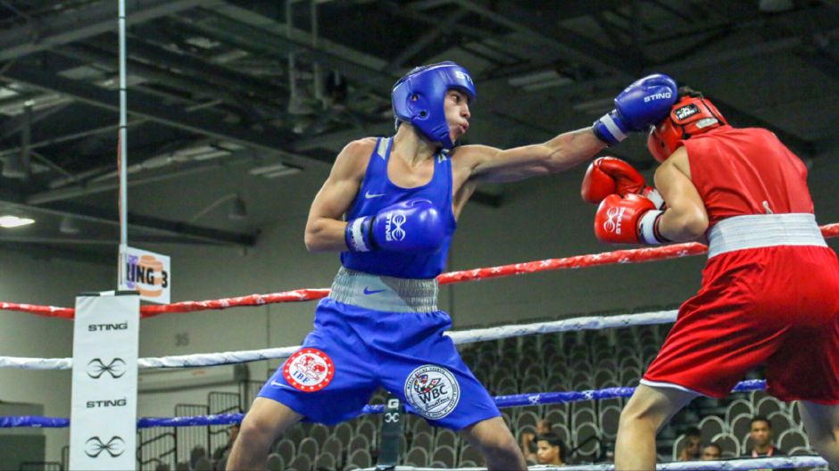 Diego Bengochea delivers a left during last weekend's USA Boxing Eastern Elite Qualifier and Regional Open Championships in Columbus, Ohio. Bengochea won both of his bouts by unanimous decision to win the 114-pound division. Photos courtesy of Miguel Bongochea