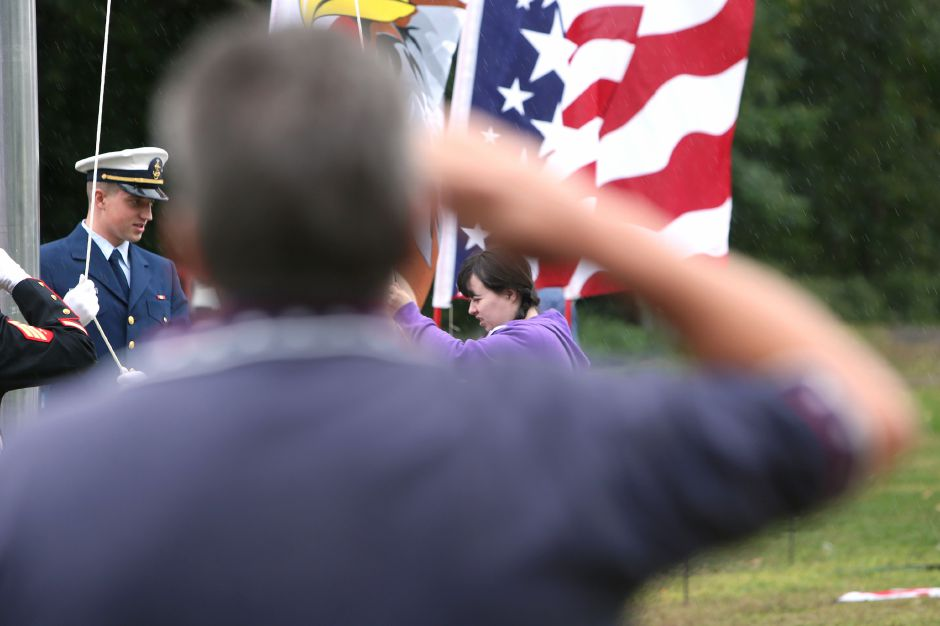 Morgan Morenz, of Meriden, raises the flag during the celebration of the American Legion's 100th anniversary at the annual American Legion Post 45 All American Picnic in Meriden on Saturday, Sept. 14, 2019. Morenz has raised more than 1,000 for Post 45 through the sales of her artwork. Emily J. Tilley, special to the Record-Journal.