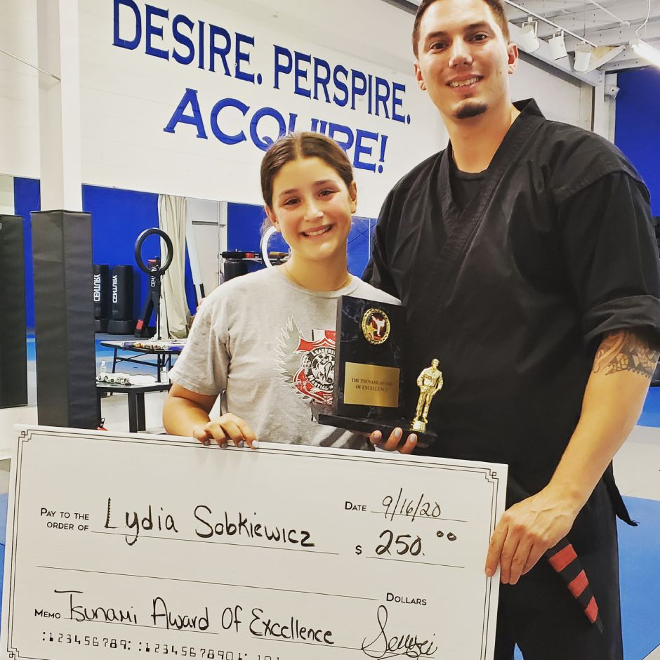 Lydia Sobkiewicz, left, a 14-year-old Southington resident, is the first recipient of Leadership Martial Arts