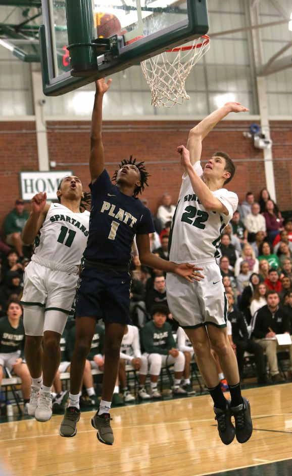 Platt's Jherquez Slater goes up for a shot against Maloney's Kamron Moreno and Garrison Kunst during a game  last season. The 2020-21 season is on course to launch with practices on January 19, pending final approval from the CIAC Board of Control this Thursday. Emily J. Tilley, Special to the Record-Journal.