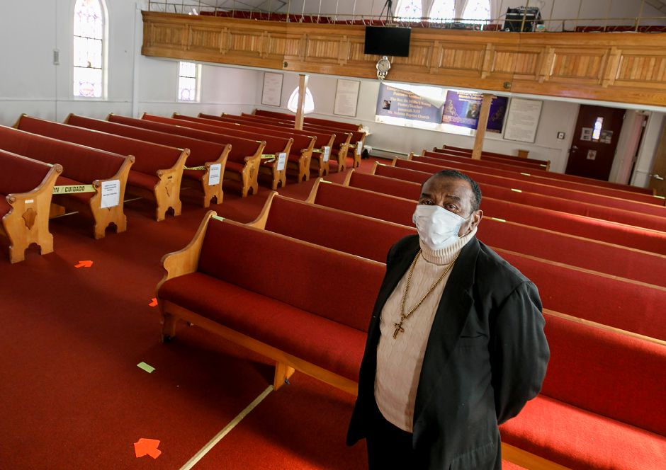 Pastor Willie Young stands in the sanctuary of Mount Hebron Baptist Church at 84 Franklin St., Meriden, on Friday. A COVID-19 vaccination clinic took place at the church on Saturday.  Photos by Dave Zajac, Record-Journal