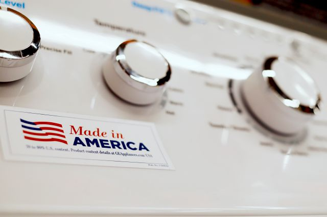 In this May 9, 2019, photo a General Electric washing machine with a label advertising it was made in America is displayed in retail stores in Cranberry Township, Pa. China has announced tariff hikes on $60 billion of U.S. goods in retaliation for President Donald Trump