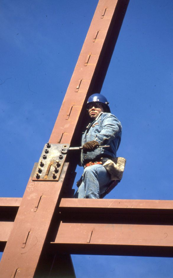 RJ file photo - Leo Robidoux, an ironworker from Continental Metalfraft of Forestville, tightens a splice plate on one of the columns that will suport the new 15-bed addition to the St. Vincent DePaul Homeless Shelter on St. Casimir Drive in Meriden, Jan. 1990.