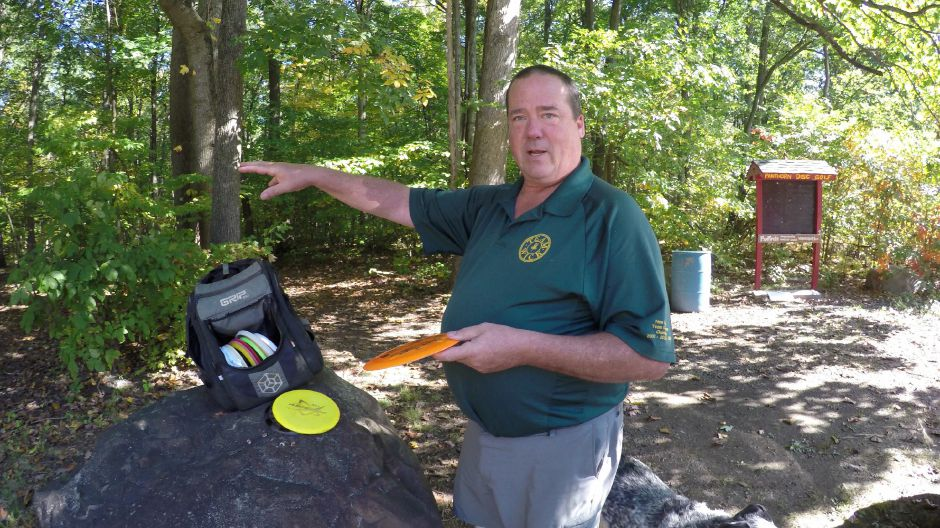 Former Connecticut State Coordinator for the Professional Disc Golf Association (PDGA), Joe Proud III of Southington demonstrates Disc throwing at the Panthorn Park disc golf course. Kristen Dearborn, Special to the Record-Journal