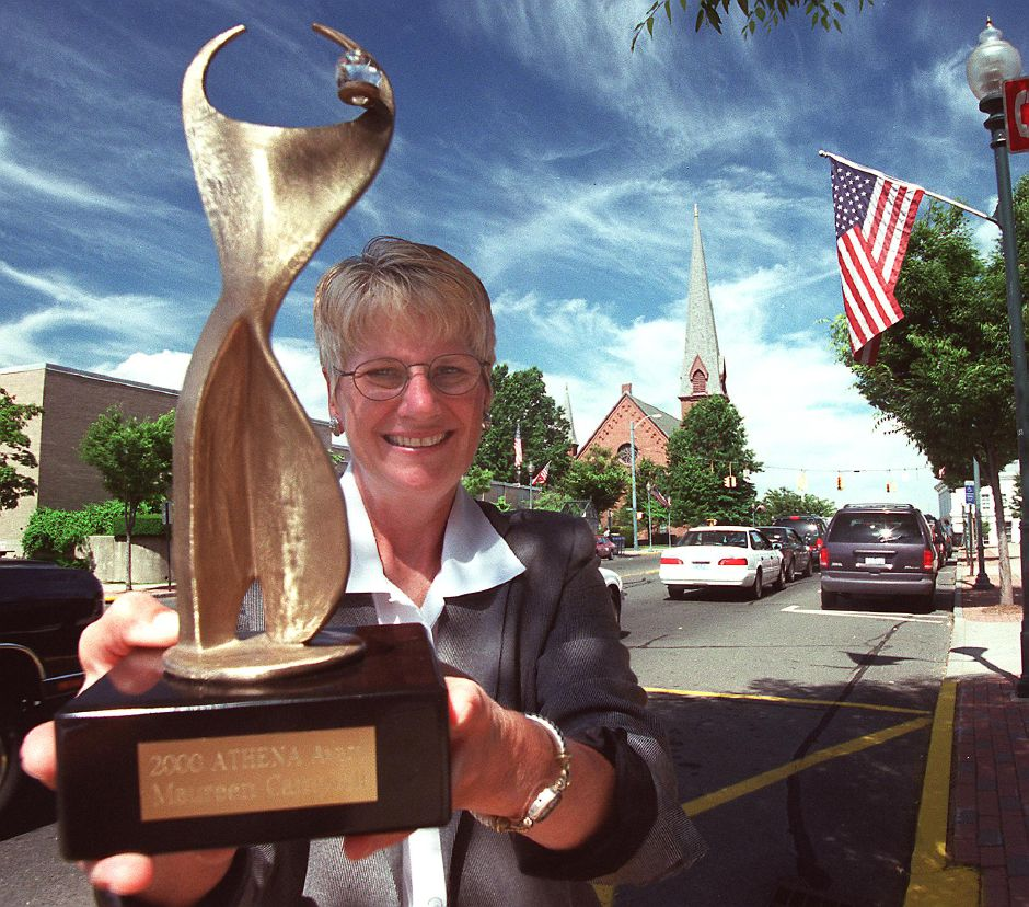 Maureen Campbell, the vice president of H. Pearce Real Estate Co., Inc in Wallingford, recently won the Athena Award which she is holding on Center Street in Wallingford, July 2000
