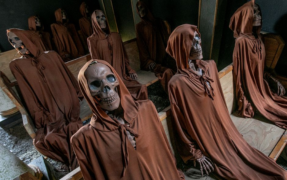 A chilling scene of skeletons are seated in a chapel at this year