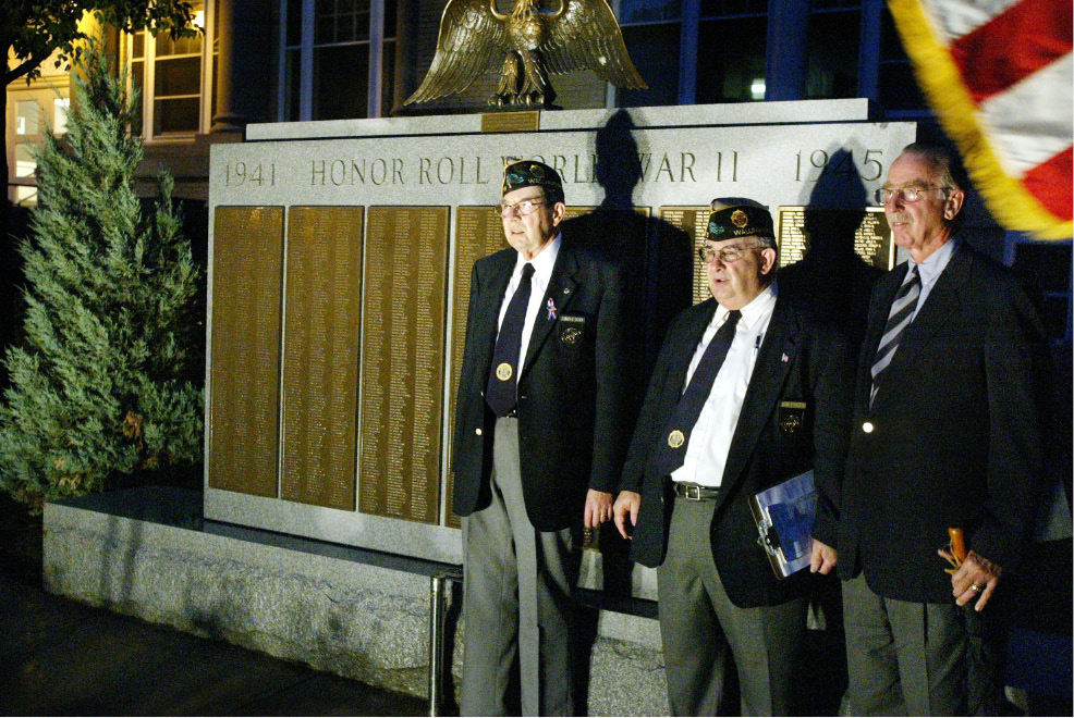 James Dunn, Commander Amer. Legion Shaw-Sinon  Post 73, left, Robert Parisi, Chairman of Town Council, center, and Edward Shanahan, Headmaster of Choate Rosemary Hall, right, in front of the renovated WWII monument that they just unveiled in front of the Wallingford Town Hall Mon. night, Sept. 2, 2002.