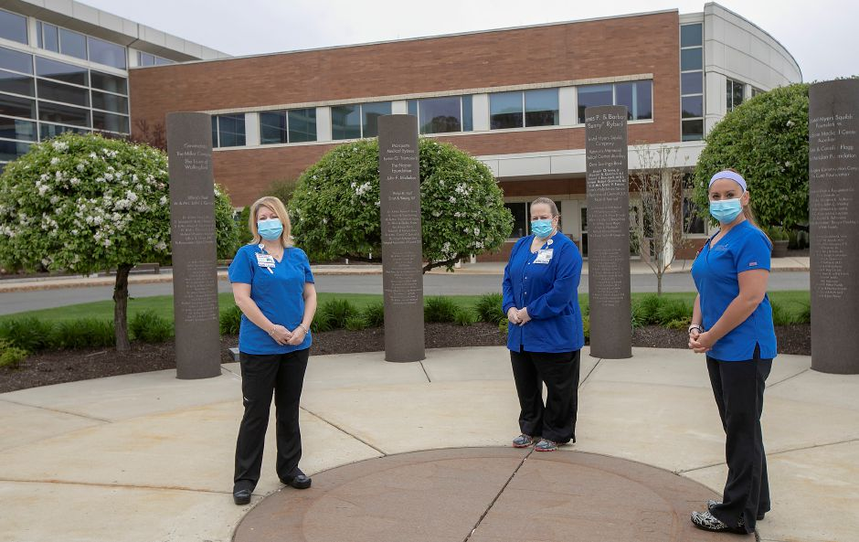 Left to right, Tara Zane, Pavilion B nurse manager, Lori Nohilly, director of inpatient nursing and critical care, and Jenn Kolakoski, Pavilion D nurse manager, stand in the garden at MidState Medical Center in Meriden, Fri., May 8, 2020. Dave Zajac, Record-Journal