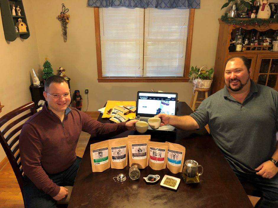 Josh Liposky (left) and Jerry Piscitelli (right),owners of Wonderland Tea Company, show off a few of their selections.  Submitted photo