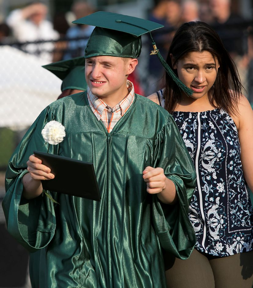 Graduate Phillip Deleon receives his diploma during graduation ceremonies at Maloney High School in Meriden, Tuesday, June 13, 2017. | Dave Zajac, Record-Journal