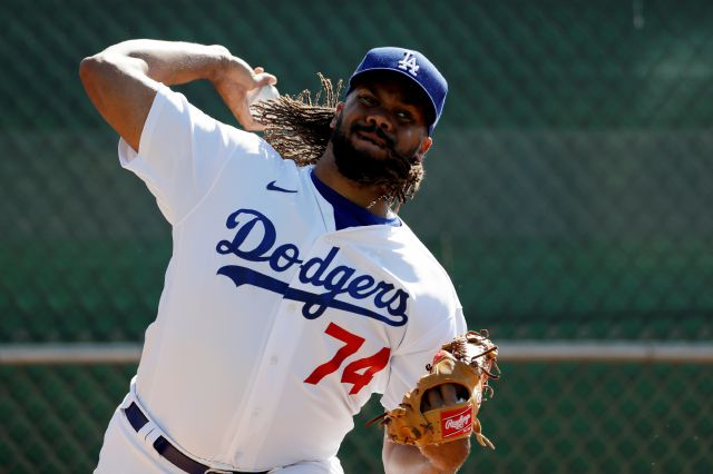 Los Angeles Dodgers relief pitcher Kenley Jansen throws during spring training baseball Wednesday, Feb. 19, 2020, in Phoenix. (AP Photo/Gregory Bull)