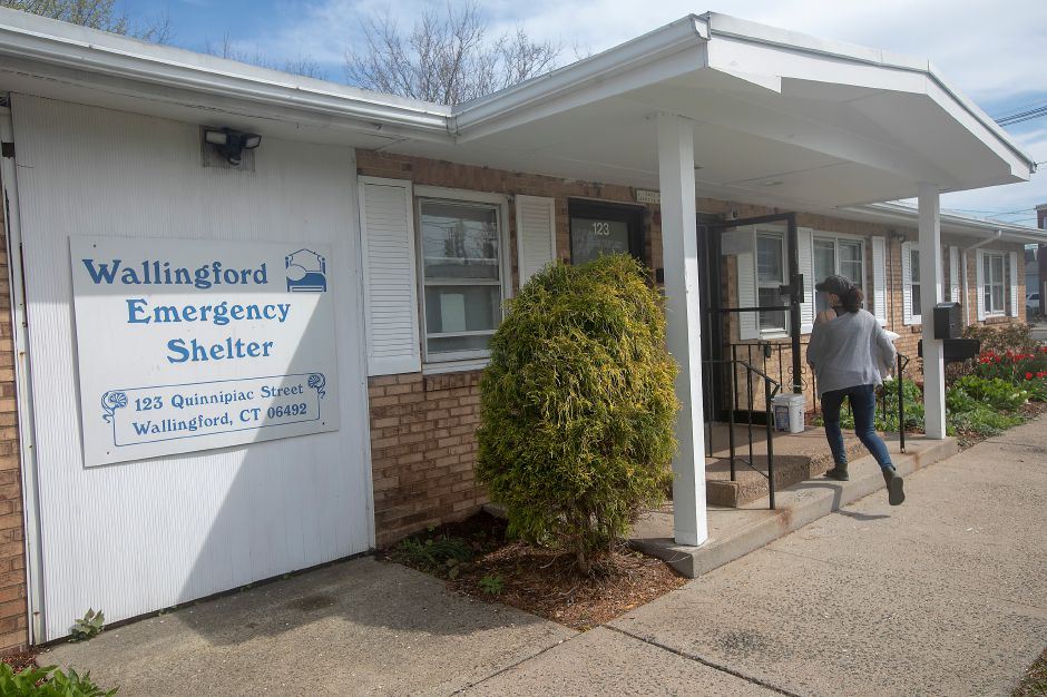 Kaylie Chudyi, of Wallingford, carries donations to the Wallingford Emergency Shelter, Tues., Apr. 14, 2020. Chudyi is a Connecticut Community Initiative volunteer. | Dave Zajac, Record-Journal