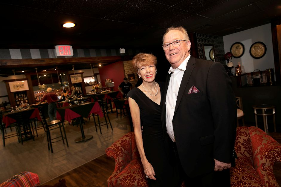 Diane Mulholland, owner of The Manhattan, poses with husband Rob Sitz in the lounge of the new 1920s-themed bar on Eden Avenue in Southington on Friday.