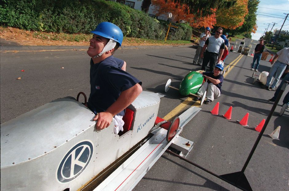 At the starting line atop Liberty Street Kyle Wentland of Bristol winces as he squirms his way into a 1950 vintage soap box derby car belonging to Lauren Humpage of Meriden Oct. 17, 1999.