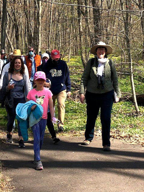 Mary Mushinsky, along with Christine and Valentina Ouijano, lead hikers along the Quinnipiac Banton Trail.