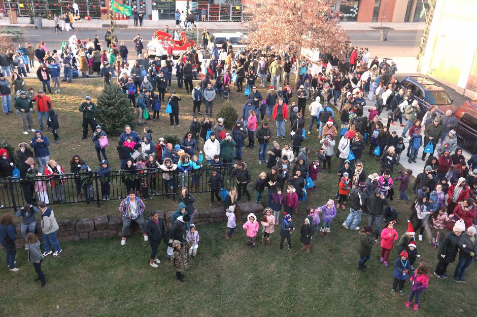A crowd of people anxiously waits to see Santa outside of the train station in Meriden during the annual Yulefest in Meriden on Saturday, Nov. 30, 2019. Emily J. Tilley, special to the Record-Journal.