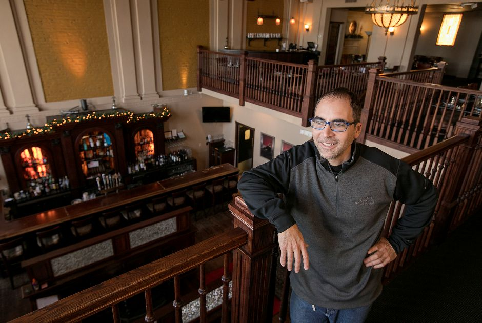 Christian Rao, owner of J. Christian's, stands in the dining room of the business at 9 N. Main St. in Wallingford, Friday, Jan. 26, 2018. Rao recently quelled rumors that he is looking to sell the restaurant.   Dave Zajac, Record-Journal