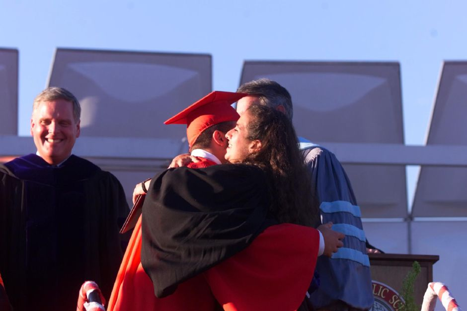 RJ file photo - Anthony Robert-Francis Ocone, gets a hug and his diploma from his sister Tina Ocone, who is a teacher at Dodd Middle school in Cheshire June 21, 1999.