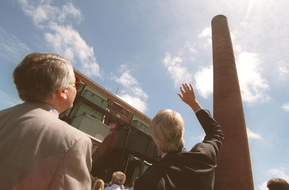 Dean Johnson, left, landscape architect, and Mark Lyons, right, project manager, discuss the new proposals for the new power plant at Alfred L. Pierce in Wallingford May 31, 2000. They are on a tour of the plant.