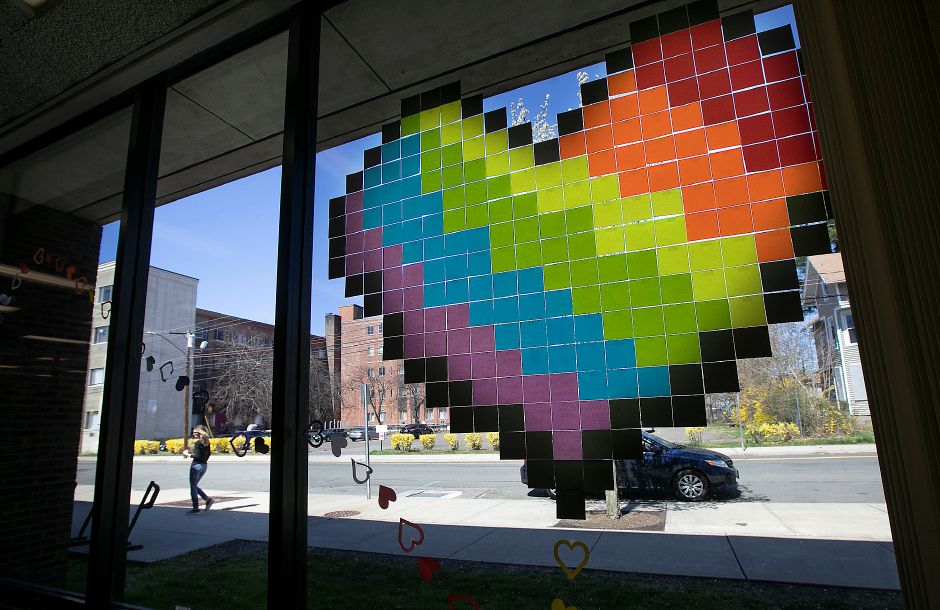 "Hearts are seen on the front windows of the Meriden Public Library, Mon., Apr. 6, 2020. The library is inviting others to join in the worldwide initiative of putting hearts in windows with a ""Spread Love Not Germs"" theme. Dave Zajac, Record-Journal"