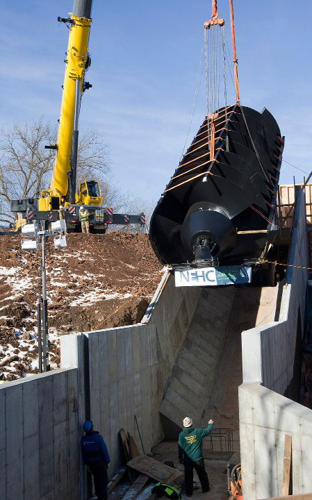 Crews help position a 20-ton, 35-foot-long metal screw into place at Hanover Dam in South Meriden, Tuesday morning, December 20, 2016. The Archimedes screw, named for the ancient Greek scientist credited with its invention, is the first of its kind installed in the U.S.  | Dave Zajac, Record-Journal