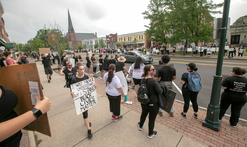 Hundreds attend a silent protest rally in solidarity with the Black Lives Matter movement along North Main Street in Wallingford, Fri., Jun. 5, 2020. Dave Zajac, Record-Journal