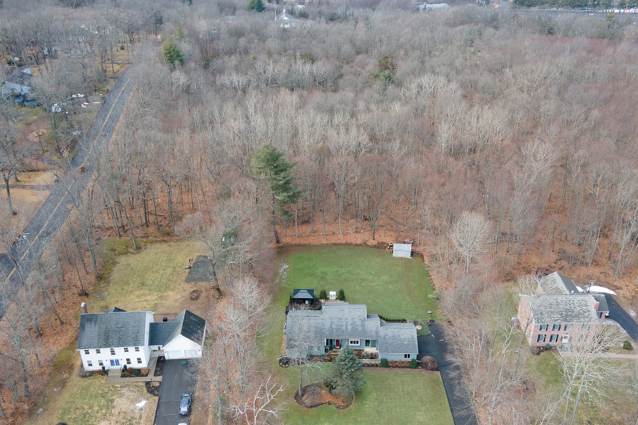 View looking west shows a wooded area proposed for a housing development behind homes on Doral Lane off Laning Street in Southington on Wednesday. Dave Zajac, Record-Journal