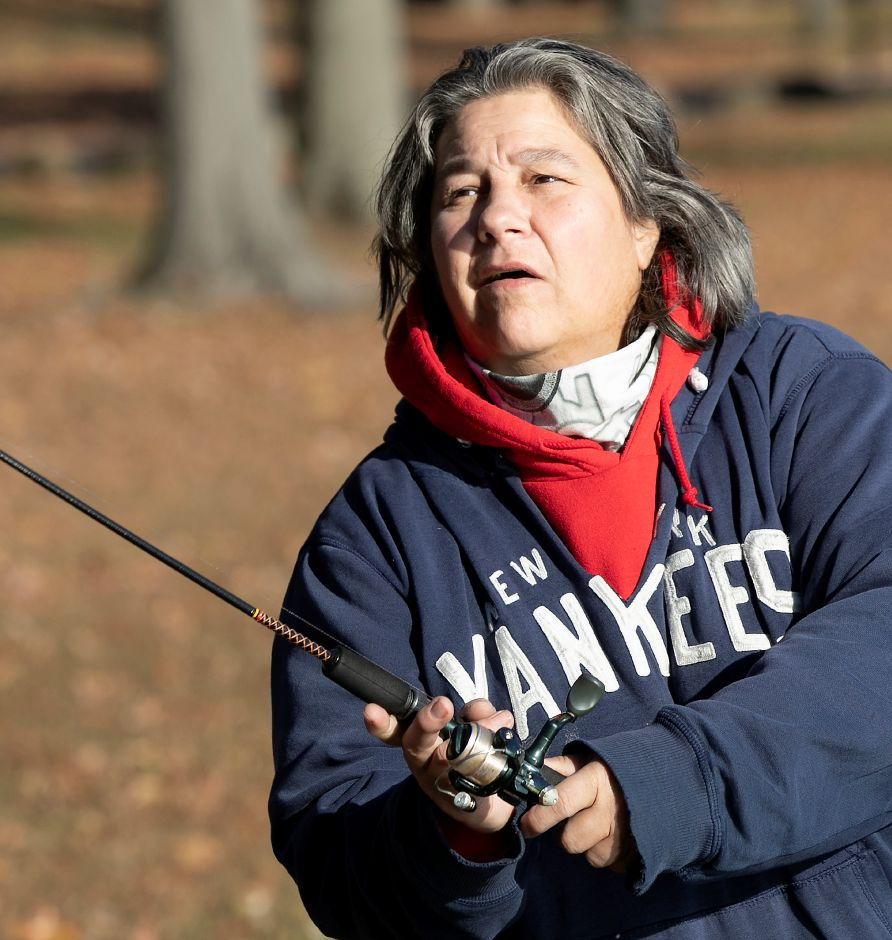 Lisa Giusti, of Meriden, casts a line into Mirror Lake on a sunny afternoon at Hubbard Park in Meriden, Fri., Nov. 15, 2019. Giusti has been fishing the lake for over 40 years with her largest catch being a 5-pound largemouth bass. She also assisted in helping a fellow fisherman reel in a 40-pound carp. Dave Zajac, Record-Journal