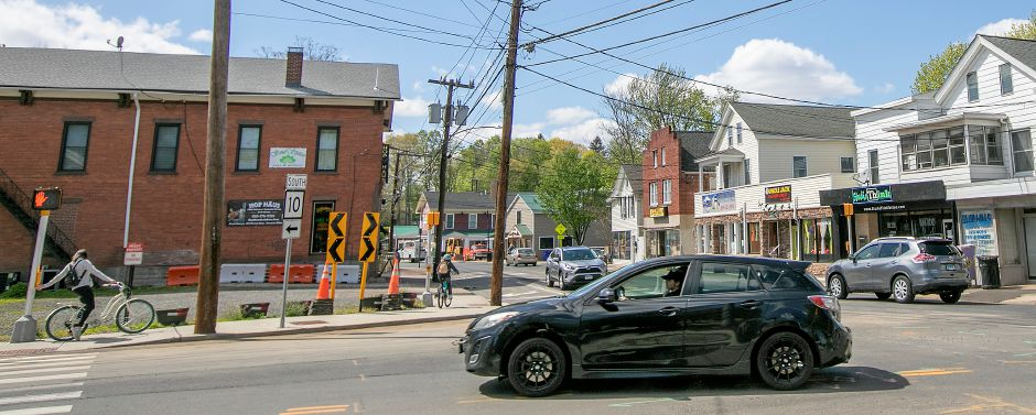 A motorist travels through the intersection of Main Street and West Main Street in Southington on Tuesday.  Southington is considering speed bumps for the downtown Plantsville area. Photos by Dave Zajac, Record-Journal