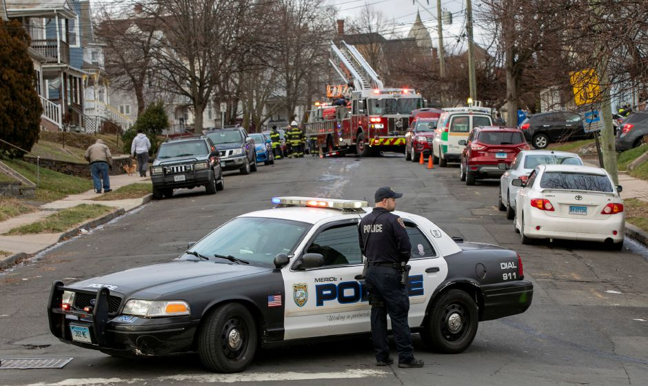 Meriden police block the road as firefighters work the scene of a house fire at 94 Linsley Ave. in Meriden, Tues., Jan. 5, 2021. Dave Zajac, Record-Journal