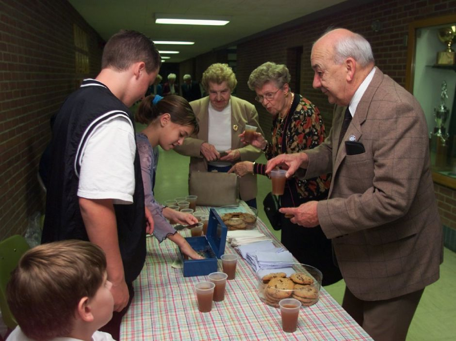 Fran Orlawski, right, and his wife Claira Orlawski, 2nd right, aloing with Dorothy Wojan, center, by some cider and cookies from members of the Lincoln Middle School Student Council before the start of the symphony at Maloney Sat., Sept. 25 1999. Serving are Ben Hoyt, 13, left, and Courtney Lehr, 12.