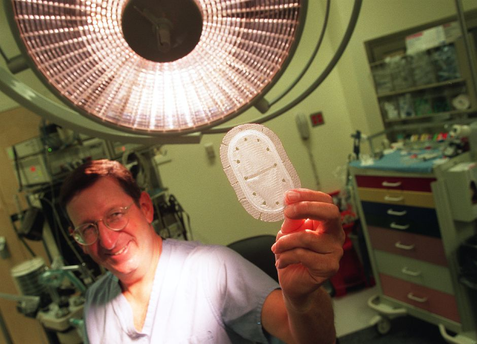 Louis Meyer, M.D. of abdominal and general surgery at MidState Medical Center in Meriden, holds up a new design for a hernia patch called the Kugel patch in an operating room in the hospital July 28, 1999. Once a month Dr. Meyer instructs other doctors on the procedure of the new patch.