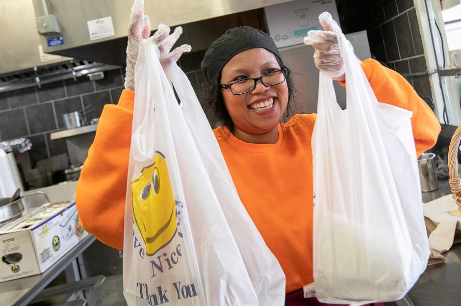 Duangjai Shuster carries an order to customers at her new restaurant, Thai-Tanic Cuisine, 784 E. Main St. in Meriden, Fri. Feb. 8, 2019. Dave Zajac, Record-Journal