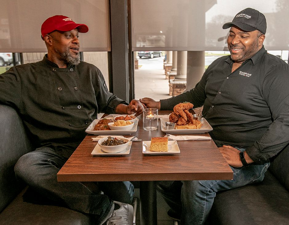 Chef Dimitri Farthing, left, and Richard Pennyman, owner of Americansoul Kitchen Bar, share in a laugh at the new restaurant at 164 Scott St. in Meriden, Tues., Nov. 12, 2019. Dave Zajac, Record-Journal