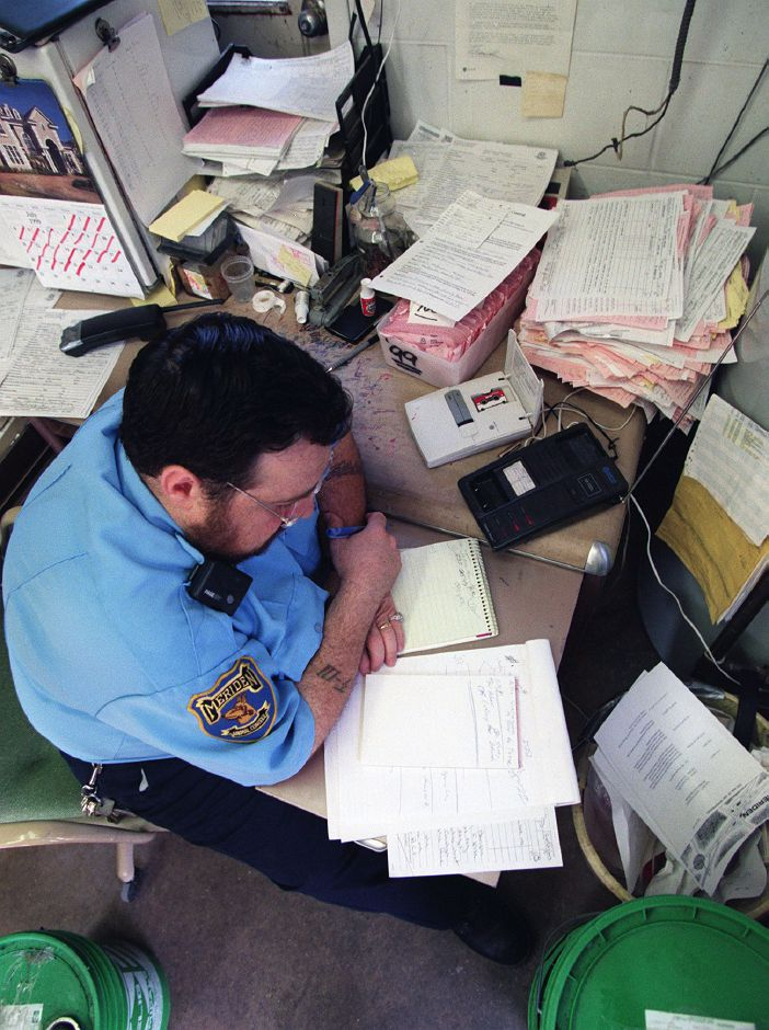 Paperwork is a big part of the job and listening to all the messages left on his answering machine is how he gets many of his complaints, July 23, 1999. He calls back every call he recieves.
